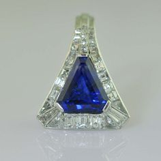 Sculptural Art Deco ring by Boucheron c1930s. Triangular-cut sapphire of  4.53 carats with a diamond surround.