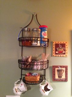 I needed a shelf for the sweeteners, stir sticks and misc. items taking up space on my coffee counter and decided that this shower caddy worked perfect!  I attached a cabinet knob to the wall to make it look as though it was supposed to hang there.  Screws were put in place at various spots to secure it to the wall and keep it from shifting.