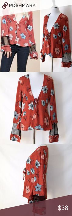 NWT MINKPINK Blouse Top Tie-front Floral Patterns New with tag MINKPINK  Have fun in fall with the Ornate blouse! With it's fun tie-front and floral pattern, this top you'll want to wear year-round!   Low cut front with tie  Sheer arm panel   Hand wash cold  Viscose blend  No care label Size S MINKPINK Tops Blouses