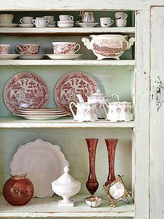 I love this display of antique dishes and serving pieces.