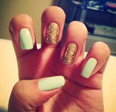 Mint green nails with gold accents