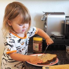 She thinks she's a big kid just like her big sisters and loves doing everything for herself - like making her own sandwiches (with Trader Joe's Speculoos Cookie Butter!)  #mathilde #sandwich #toddler #traderjoes #speculooscookiebutter #littlehelper #2yearsold