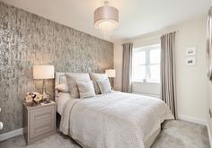 This master bedroom cleverly combines layered linens and calming tones of cream and grey.