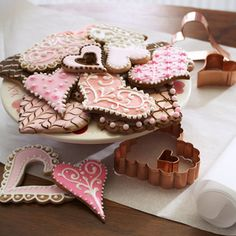 Valentine's Day cookies, @Chrissy Loftis, I love the filligree looking ones, like the darker pink one on the table in front of the tray. This isn't a design I've done before, but I think it could be worth trying out...
