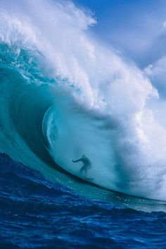 "Garrett McNamara in a huge barrel at Peahi or ""Jaws,"" north shore of Maui, Hawaii..."