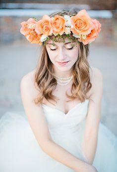 Brides.com: . A peach rose flower crown by Laura Hickman Designs pops against this bride's pretty waves.