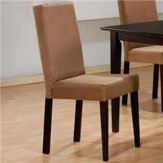 This lovely dining side chair will be a welcome addition to your casual contemporary dining space. The parson style chair has a simple high back and padded seat covered in rich deep mocha colored microfiber, above sleek square tapered legs. This durable and comfortable chair will blend easily with your decor to create a warm and relaxing dining environment. Pair with the matching table for a complete dining room ensemble.