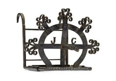 A small wrought iron sliding bar-grate toaster, probably Scottish 17th century