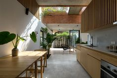 Photo 4 of 10 in Indoor Gardens Bring Light and Air Into This Brick… The kitchen, dining area, and living room seamlessly flow together, making the first floor seem more spacious. Concrete Houses, Concrete Floors, Vietnam, Hanoi, High Building, House Floor Plans, Interior Architecture, Interior Design, Brick