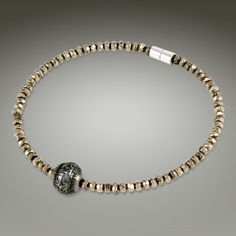 Moana means ocean to the Polynesians. This confident and chic collection of chokers and bracelets complemented with natural black spinel or exotic pyrite bring to mind deep shimmering tones that dance across a midnight ocean on a moonless night. Sleek magnetic clasp gives the clean lines of each piece a seamless look, and continue the ultra-chic appeal.