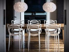 Kartell Masters Chair designed by Philippe Stark and Eugeni Quitllet. So lightweight that it can be used for indoor or outdoor dining.