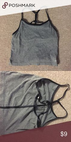 Strappy crop workout tank! Adjustable straps, built in shelf bra, slightly cropped. Looks good with high waisted leggings. Forever 21 Tops Crop Tops