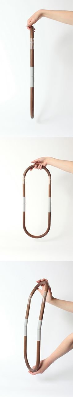 """Wooden void"" necklace / walnut tube, gold plated brass/ rubber Royal College of Art 2013 www.marinastanimirovic.com"