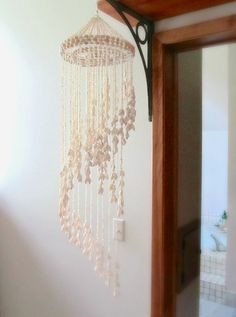 cascading cowrie shell wall hanging tropical macrame chandelier