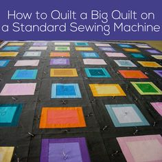 """I know. You look at that mass of quilt and you look at the space under the arm of your sewing machine and you think, """"No way!"""" You'd be wrong. You can totally quilt a big quilt on a regular sewing machine. I've actually quilted king size quilts on my machine – though in this …"""