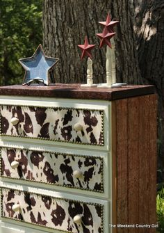 DIY project!  Cowhide and nailhead trim on an old dresser!  Cowgirl cool