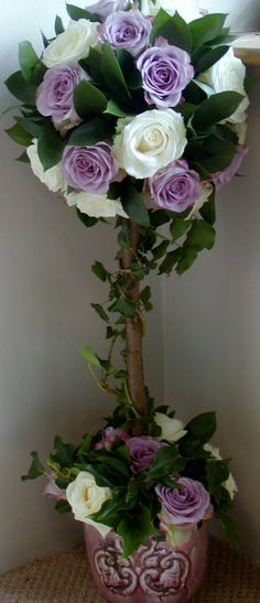 Topiary tree of two types of roses, Avalanche and Memory Lane. Greens are Ivy and Ruscus