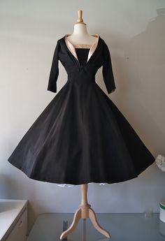 """1950s silk faille """"New Look"""" era party dress with full skirt and matching bolero jacket. Lined in pink satin. From Bullocks Wilshire."""