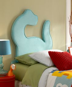 Dinosaur twin headboard for a little boy's room. Cute- a big piece of foam, could do other shapes as well. I don't have a boy but how cool is this!