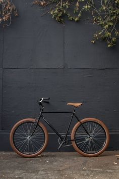Black single speed bike with tan leather seat