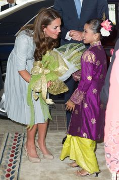 Kate Middleton may have been arriving for lunch with the prime minister, but she made time for a sweet greeting with this little girl during...