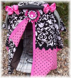 Carseat cover.  No more big bulky blankets that can get caught and torn off by the wind. This carseat cover is attatched to your carseat by straps. They are great to keep the germs off your little one especially through flu season. Also great for keeping the wind, sun and rain off your little one. You will also look great sporting around this carseat and you wont believe the compliments you will recieve.   The flower is attatchable so if you dont want it on the carseat you can wear it on a hat,headband or just in the hair.   If there is a specific color or style you are looking for that I dont have let me know and I can custom make one for you.  Please allow 7-14 days for order.     JUST SNAP AROUND NECK FOR AMAZING NURSING COVER.....2 IN 1