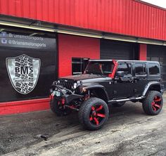 BLACK JEEP JK WITH 6 IN LIFT MATCHING WHEELS AND PAINTED LED BAR BRACKET