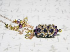 Autumn Majesty Tudor style beadweaving necklace. Amethyst Swarovsi crystals, 14k gold and rose gold plated chain.