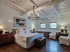 Renovated barn. Love the beadboard, light fixture, beams in ceiling, white slipcovered chairs.