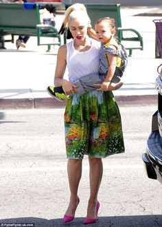 00084e5311619 Gwen Stefani and sons head for church all dressed in bright ensembles