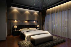 Elegant dark master bedroom design with dark hard wood floor, dark walls, built-. Elegant dark master bedroom design with dark hard wood floor, dark walls, built-in lighting and large dark rug