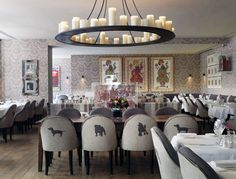 Haymarket Hotel.  Brumus Bar and restaurant. Love the animal silhouettes on backs of chairs! Kit Kemp designer. London. -via Interior Canvas