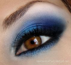 A range of intense blue eyeshadows with black liner for brown eyes