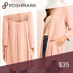 Strappy Back Long Cardigan Salmon colored. Strappy Back. Hidden side pockets. S/M/L available Sweaters Cardigans