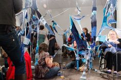 Sarah Filmer's installation in Southampton. A mass participatory knitting piece, all participants must add to a knitting piece using blue wool. Read the piece for context, it's fascinating