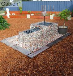 gabion water feature in the garden http://www.gabion1.com