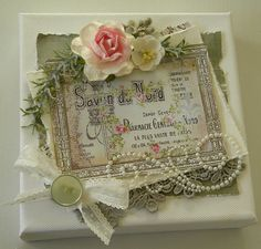 Gorgeous altered canvas. - the swirled pearl flourish that follows the lace applique is especially nice - #altered #art #mixed #media #canvas #crafts - ≈√