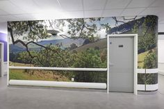 Local landscape in a corridor at Chesterfield Royal Hospital. Artwork by Artinsite. Healthcare Architecture, Wall Cladding, Health Care, Aquarium, Garage Doors, Chesterfield, Landscape, Interior, Outdoor Decor
