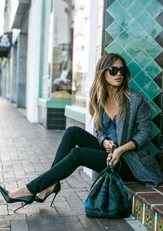 Rachel Barnes is wearing a backpack from Simone Camille, grey blazer from Love Stitch Clothing, leather cami from Cami NYC, black jeans from Paige denim and the shoes are from Zara