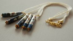 A pendant made of paper beads. The paper is a detail of an old map #Sicily #paperbeads #old map