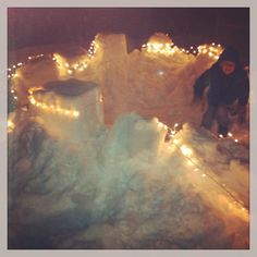 This was the Epic Snow Fort we made the day after Christmas last year. We used Tupperware Totes to make the walls, and put white lights all around the perimeter for the glimmer at night. Our yard was the magnet of the neighborhood, with kids everywhere!