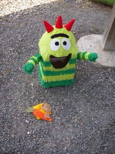 This Brobee is made out of cardboard, paper mache, crepe paper, felt, and styrofoam!