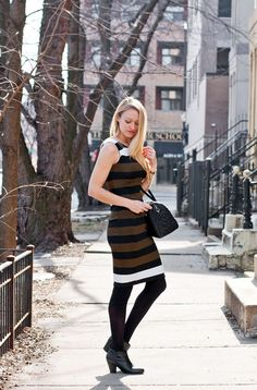 Striped sheath dress, opaque tights, ankle boots, and a bold blazer.