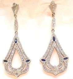 1920s Diamond Loop Drop Earrings. Platinum Long open Tear Drop Shape flexible dangle drop earrings consisting of numerous old European Cut Diamonds weighing approximately 3 carats of fine quality diamonds embellished with navette cut onyx stones for pierced ears only European Made In the 1920's