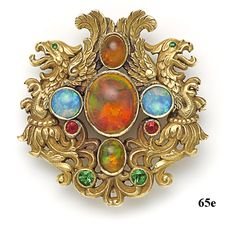 Griffin brooch by an unknown maker, signed T.B. Starr. Gold set with fire opal, opal, demantoid garnet and ruby cabochons   Courtesy Nelson Rarities