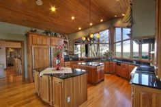 Luxurious timber frame home w/ great views of Watts Bar Lake! 4 fps, pool, boat slip. Post and Beam const, oak flrs, doors and trim. Kit is cook s dream cherry cabinets and professional grade appliances. Cathedral ceilings, sauna on deck, lighting/sound/vac system thoroughout. Amazing custom details! $1,500,000 Offered by The Pozy Team Knoxville Real Estate