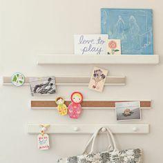 I would like to try and make my own cork rail.  I feel like it could easily be done with a strip of baseboard and cork!  Display-It Rails from PBteen.