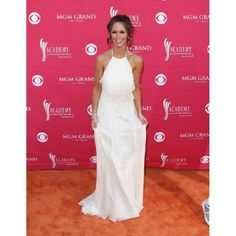 HOST PICK. Replica white halter prom dress HOST PICK! This is a replica of the white halter dress that Jennifer Love Hewitt wore to the 2009 ACM Awards. I wore it once paired with the gold Jessica Simpson pumps also listed in my closet. Fun, comfortable, flowy! Dresses Prom