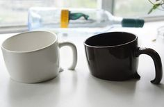 """Japanese are good at design - Designer """"buried"""" coffee cup  Resembling a treasure chest half-buried in the sand, the Treasure Mug is a coffee cup in two colors (white or brown) and a very unique design. The base is slanted and handle slightly trimmed so at first glance they seem to bea actually sinking into the table."""