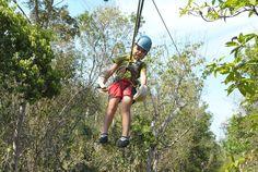 My seven year old ziplining at Aventuras Mayas in the jungle of the Riviera Maya, Mexico.    www.aventurasmayas.com